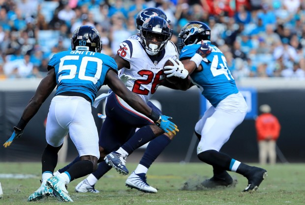 Houston Texans running back Lamar Miller running the ball against the Jacksonville Jaguars
