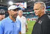 Former North Carolina Tar Heels head coach Larry Fedora and Miami (Fla.) Hurricanes head coach Mark Richt shake hands after their two teams battled on the field