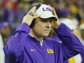 Former LSU Tigers head coach Les Miles waits near the bench before the start of the AdvoCare V100 Texas Bowl against Texas Tech Red Raiders