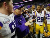 Former LSU Tigers head coach Les Miles sings following the AdvoCare V100 Texas Bowl win over the Texas Tech Red Raiders