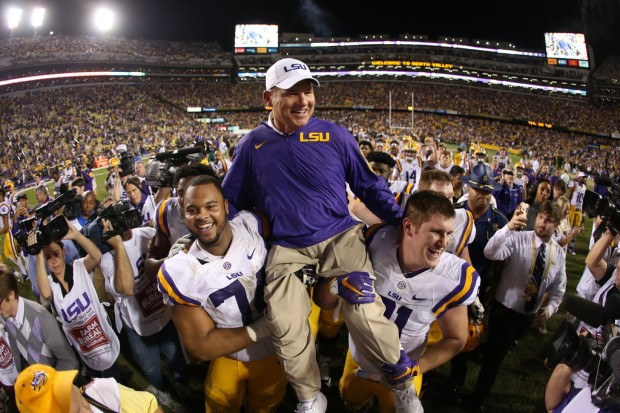 Former LSU Tigers head coach Les Miles being carried off the field by his players after the Texas A&M Aggies game