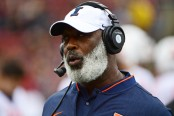 Illinois Fighting Illini head coach Lovie Smith coaches from the sidelines against the Rutgers Scarlet Knights
