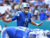 Detroit Lions quarterback Matthew Stafford calls out signals against the Miami Dolphins