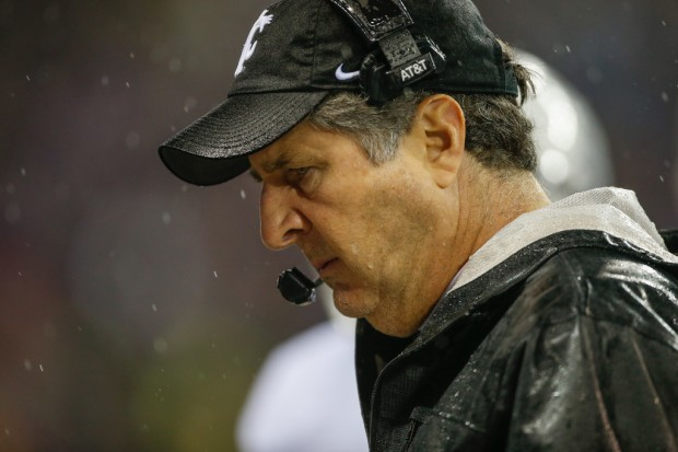 Washington State Cougars head coach Mike Leach looks on against the Washington Huskies