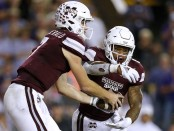 Mississippi State quarterback Nick Fitzgerald hands the ball off to running back Kylin Hill against the LSU Tigers