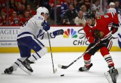 Former Chicago Blackhawks center Nick Schmaltz playing the puck against the Toronto Maple Leafs