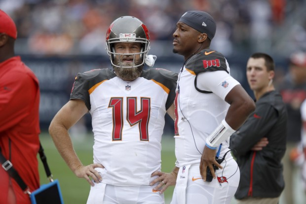 Tampa Bay Buccaneers quarterbacks Ryan Fitzpatrick and Jameis Winston stand on the sidelines against the Chicago Bears