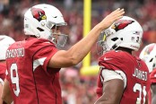 Former Arizona Cardinals quarterback Sam Bradford celebrating a touchdown with David Johnson