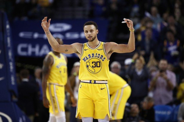 "Golden State Warriors guard Stephen Curry reacts after the fans chant ""MVP"" against the Washington Wizards"