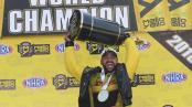 DHL Funny Car pilot J.R. Todd with the championship trophy