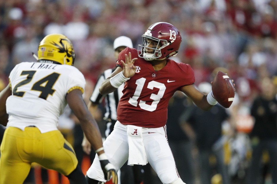 Alabama Crimson Tide quarterback Tua Tagovailoa attempting a pass against the Missouri Tigers