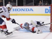 Florida Panthers center Vincent Trocheck helps teammate James Reimer make a stop against the New York Islanders