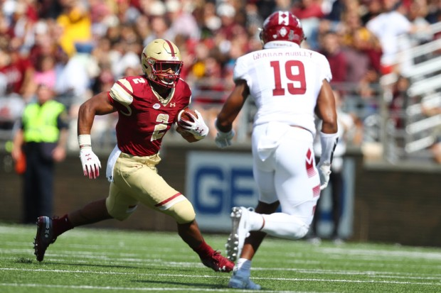 Boston College Eagles running back AJ Dillon running the ball against the Temple Owls
