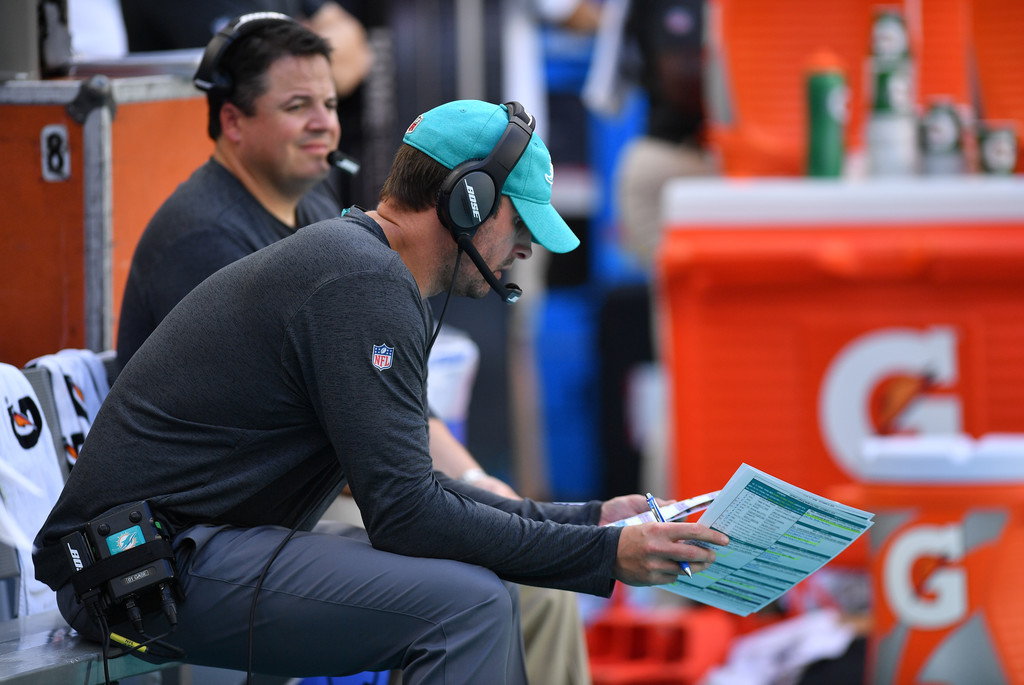 Former Miami Dolphins head coach Adam Gase looks on from the bench against the Detroit Lions