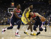 Former Washington Wizards guard Austin Rivers going to the basket against the Golden State Warriors