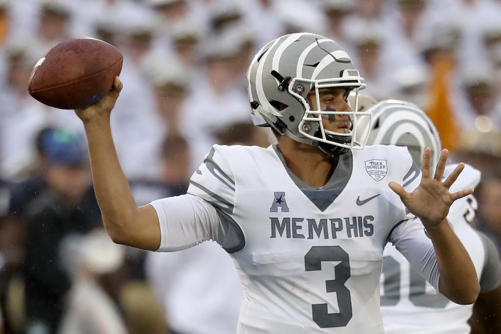 Memphis Tigers quarterback Brady White attempts a pass against the Navy Midshipmen