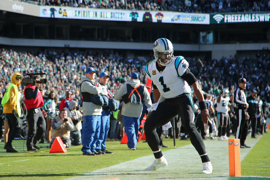 Carolina Panthers quarterback Cam Newton laughs after replacing the pylon after tripping over it against the Philadelphia Eagles