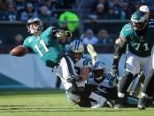 Philadelphia Eagles quarterback Carson Wentz is being sacked by Carolina Panthers linebacker Luke Kuechly