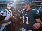 Philadelphia Eagles quarterback Carson Wentz congratulates Carolina Panthers quarterback Cam Newton following their win