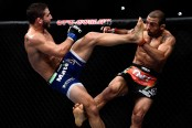 MMA fighter Chad Mendes kicks José Aldo at UFC 179