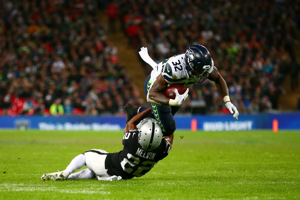 Seattle Seahawks running back Chris Carson is tackled by Oakland Raiders' Rashaan Melvin during the 2018 NFL International Series