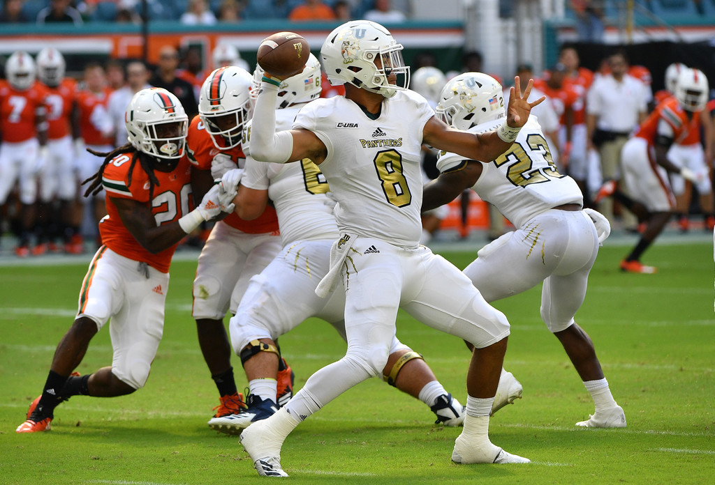 FIU Panthers quarterback Christian Alexander attempting a pass against the Miami (Florida) Hurricanes