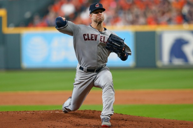 Cleveland Indians pitcher Corey Kluber delivers a pitch against the Houston Astros in the 2018 MLB playoffs