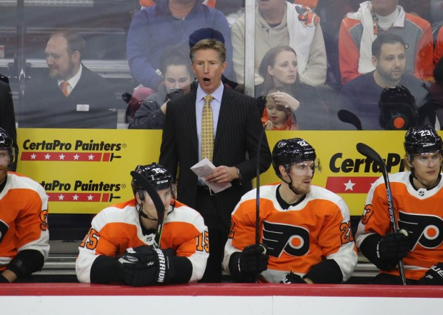 Former Philadelphia Flyers head coach Dave Hakstol coaching against the Colorado Avalanche