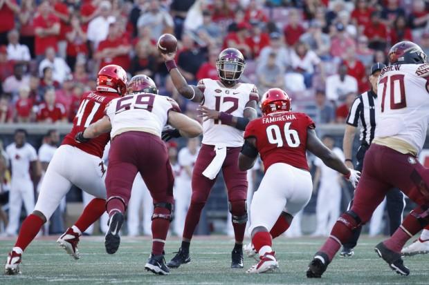 Florida State Seminoles quarterback Deondre Francois attempts a pass against the Louisville Cardinals