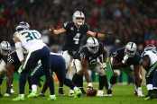 Oakland Raiders quarterback Derek Carr shouts out a call against the Seattle Seahawks in the 2018 NFL International Series