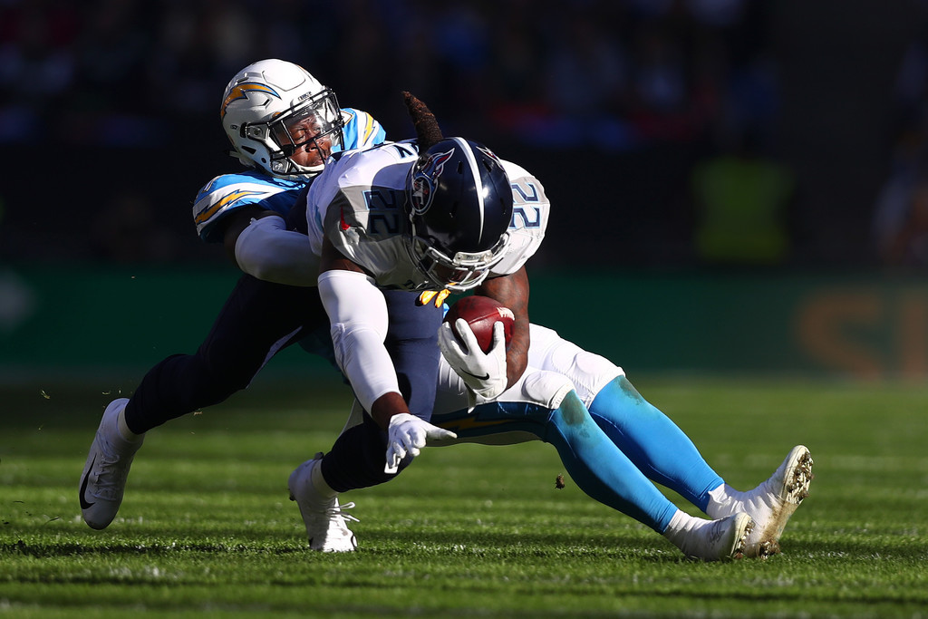 Tennessee Titans running back Derrick Henry rushing for extra yardage against the Los Angeles Chargers In the 2018 NFL International Series
