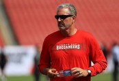Former Tampa Bay Buccaneers head coach Dirk Koetter looks on before the team's game