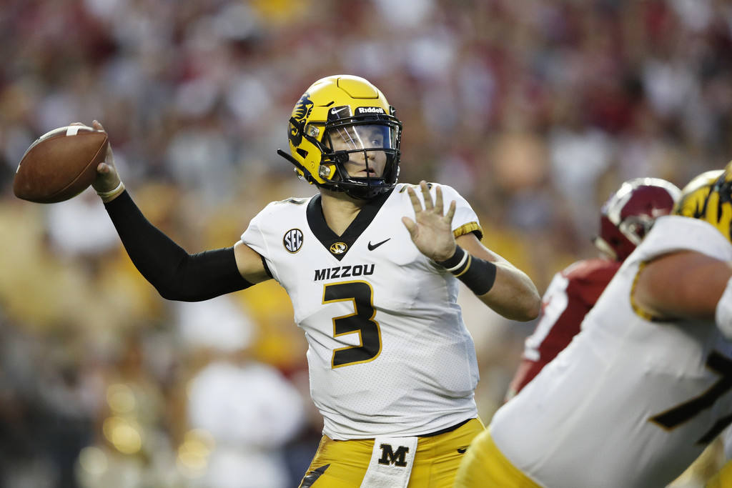 Missouri Tigers quarterback Drew Lock attempts a pass against the Alabama Crimson Tide