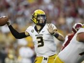 Missouri Tigers quarterback Drew Lock attempts a pass against the Alabama Crimson Tide