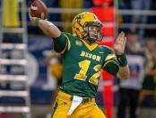 North Dakota State quarterback Easton Stick attempts a pass against Illinois State Redbirds