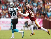 Carolina Panthers tight end Greg Olsen cannot make a reception against the Washington Redskins