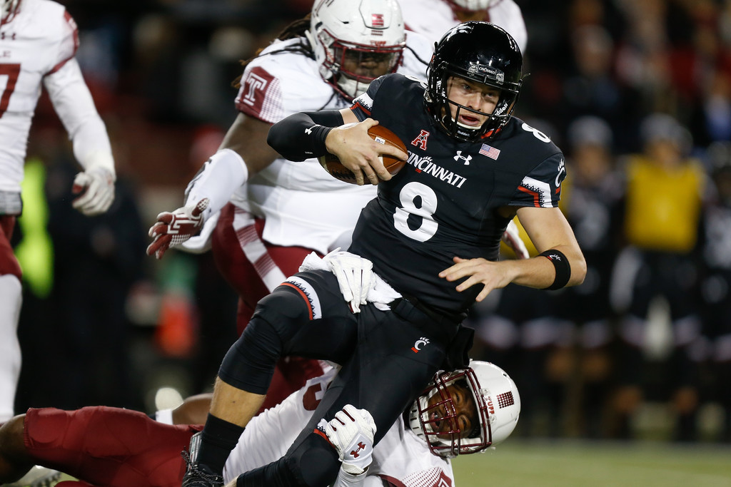 Cincinnati Bearcats quarterback Hayden Moore is sacked by Quincy Roche against the Temple Owls