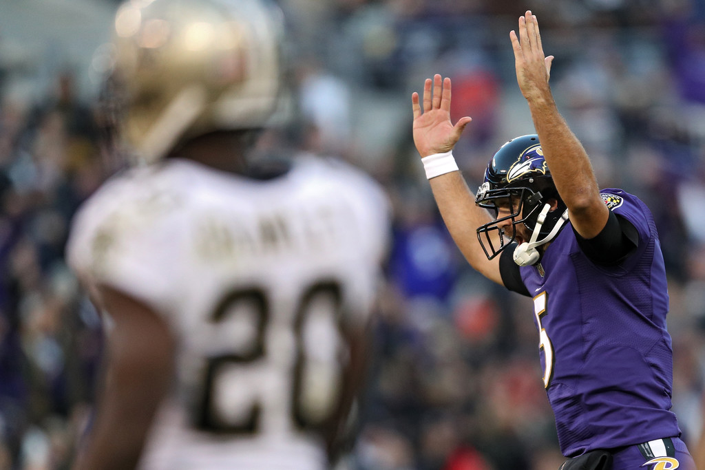 Baltimore Ravens quarterback Joe Flacco celebrates a touchdown against the New Orleans Saints