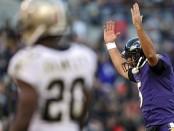 Baltimore Ravens quarterback Joe Flacco celebrates a touchdown against the New Orleans Saints