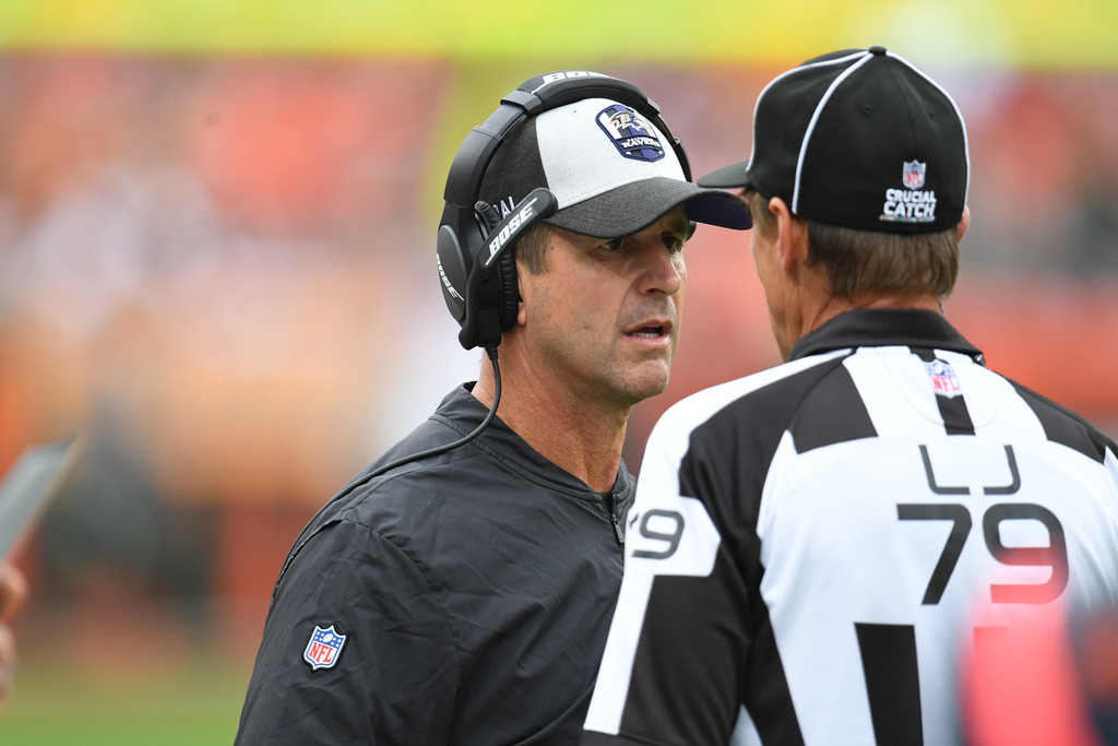 Baltimore Ravens head coach John Harbaugh exchanges words with a line judge against the Cleveland Browns