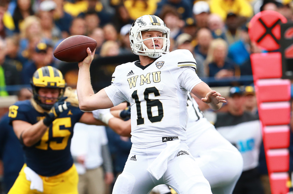 Western Michigan Broncos quarterback Jon Wassink attempting a pass against the Michigan Wolverines
