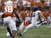 TCU Horned Frogs quarterback Jonathan Song attempting a field goal against the Texas Longhorns