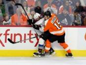 Philadelphia Flyers forward Jori Lehterä hits Matt Calvert against the Columbus Blue Jackets