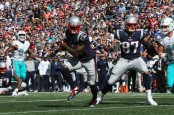 Former New England Patriots wide receiver Josh Gordon runs with the ball against the Miami Dolphins