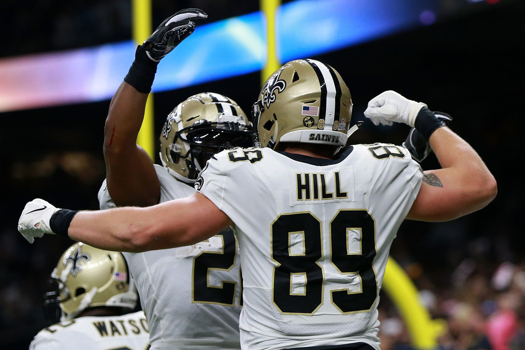 New Orleans Saints tight end Josh Hill celebrates his touchdown with a teammate against the Washington Redskins