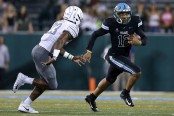 Tulane Green Wave quarterback Justin McMillan running the ball against the Memphis Tigers