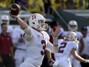 Stanford Cardinal quarterback K.J. Costello attempts a pass against the Oregon Ducks