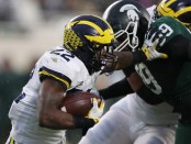 Michigan Wolverines running back Karan Higdon rushing the ball against the Michigan State Spartans