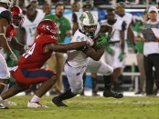 Marshall Thundering Herd running back Keion Davis running the ball against the Florida Atlantic Owls