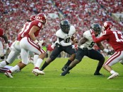 Army Black Knights quarterback Kelvin Hopkins Jr. looks for a hole to run through against the Oklahoma Sooners